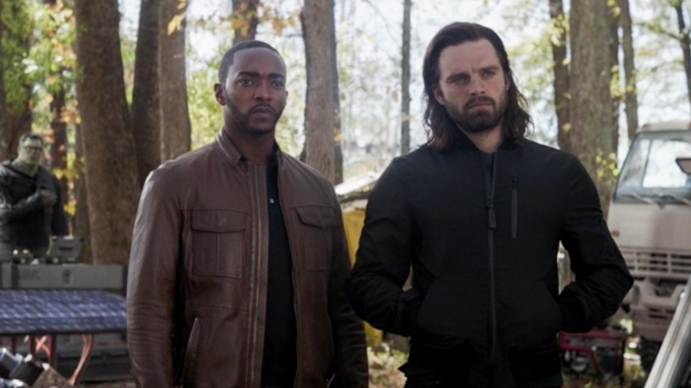 Sam and Bucky stand in the trees