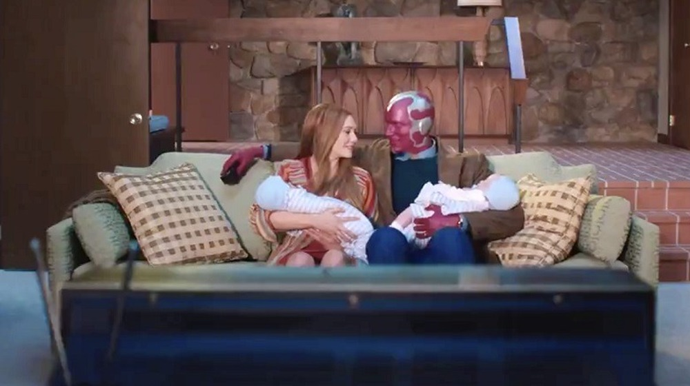 Wanda and Vision sitting on the couch with their twins