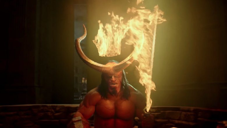 Hellboy with horns and a flaming sword