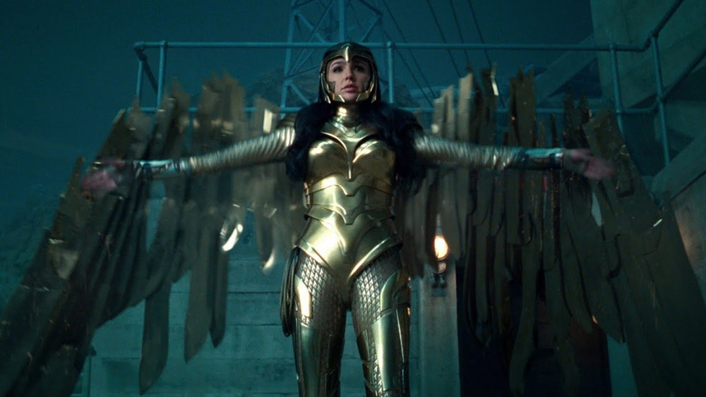 Wonder Woman striding into battle in her gold armor