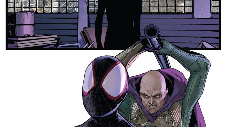 Mysterio trying to hit Miles with a pipe